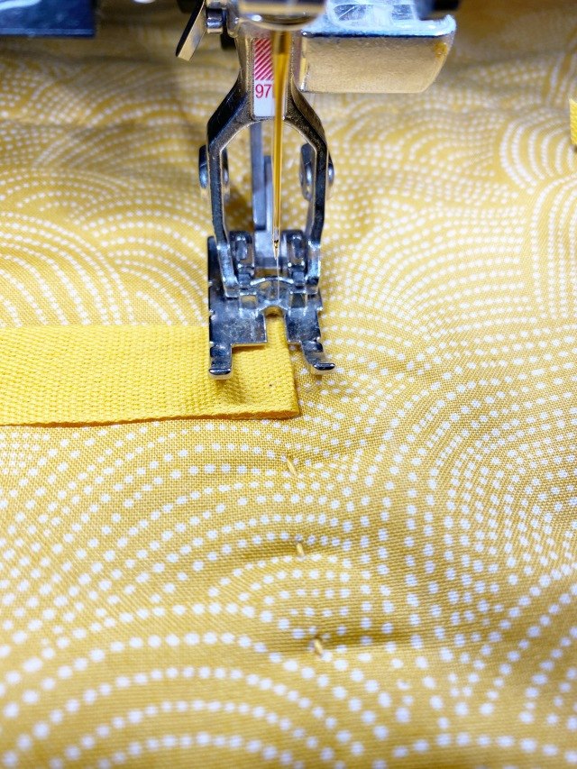 Quilted Travel Roll: Stitch the ribbon on the inside